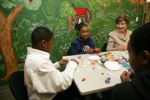 Mrs. Laura Bush sculpts clay with participants of the Communications Through Art program at the Knox County Public Defenders Community Law Office in Knoxville, Tennessee, Wednesday, October 11, 2006, as part of the President's Helping America's Youth program. Communications Through Art program uses the arts to help young people express themselves and to deal with important issues of the day. White House photo by Shealah Craighead