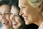 Photo of three women smiling.