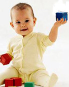Image of a baby playing with blocks