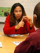 Image of a woman teaching a child Finger Spelling