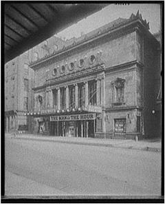 Black and white photo a theatre in Illinois with a sign reading, The Man of the Year.