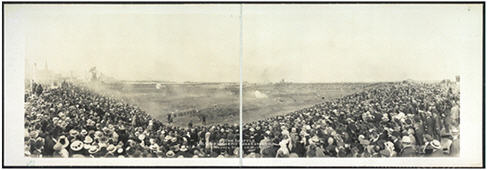 Crowds of spectators seated in an outdoor arena for a show.
