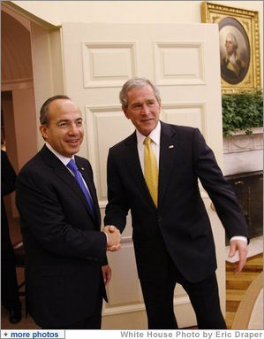 President George W. Bush greets Mexico's President Felipe Calderon for their meeting Tuesday, Jan. 13, 2009, in the Oval Office at the White House. White House photo by Eric Draper