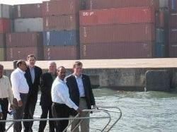 HHS Secretary Michael O. Leavitt tours the Port of Cochin in Kerala State with Indian port officials. He is joined by the Commissioner of the HHS Food and Drug Administration, the Honorable Andrew von Eschenbach, M.D., and U.S. Consul General David Hopper.