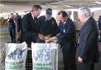 Secretary Leavitt pouring oregano into a paper bag in El Paso, Texas with Jack Grady, Consumer Safety Inspector of the Food and Drug Administration (FDA) within the U.S. Department of Health and Human Services (HHS), Luis C. Chavarría, Supervisory Investigator for the HHS Food and Drug Administration (FDA), and the Commissioner of the HHS Food and Drug Administration (FDA), Andrew C. von Eschenbach, M.D. (left). HHS photo by John Mallos