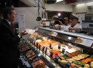 Secretary Leavitt tours the Reading Terminal Market in Philadelphia, where he visits with a merchant who sells imported seafood. Foreign products are sold throughout the market.