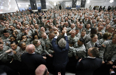 President George W. Bush reaches to shake as many hands as possible as he meets with U.S. military and diplomatic personnel Sunday, Dec, 14, 2008, at the Al Faw Palace-Camp Victory in Baghdad. White House photo by Eric Draper