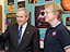 President Bush talks with a man in a classroom