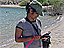 Photograph of Dyuti Sengupta using a handheld computer to mark the location of tamarisk
