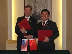 December 4, 2008 - U.S. Secretary of Health and Human Services (HHS) Mike Leavitt and his counterpart from the People's Republic of China, the Honorable Chen Zhu, M.D., after they renewed for another five years the Protocol on U.S.-China Cooperation in the Science and Technology of Medicine and Public Health, the framework document that governs work on health between the two nations. The ceremony took place on the sidelines of the fifth session under the United States-China Strategic Economic Dialogue, in Beijing, capital of the People's Republic of China.