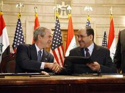 """December 14, 2008 – President George W. Bush and Iraqi Prime Minister Nuri al-Maliki shake hands following the signing of the Strategic Framework Agreement and Security Agreement at a joint news conference at the Prime Minister's Palace in Baghdad. President Bush said, """"The agreements represent a shared vision on the way forward in Iraq."""" (Photo Credit: White House photo by Eric Draper)"""