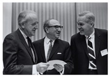 [Dr. Robert Q. Marston, Wilbur Cohen, and Dr. Hudson at a Regional Medical Programs meeting]. [ca. 1968-1973].