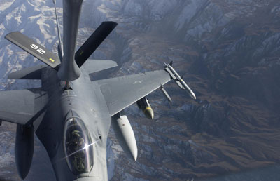 An F-16 Fighting Falcon from the 174th Fighter Wing, Syracuse, New York, receives fuel from a KC-135 from the 192nd Air Refueling Wing, Fairchild Air Force Base, over Afghanistan while supporting Operation Enduring Freedom, Nov. 29 ,2003. The 174th Air National Guard wing has both a federal and state mission. The federal mission is to provide combat ready personnel, aircraft, and equipment for worldwide deployment and the state mission is to support civil authorities at the direction of the New York State Governor in times of crisis. (U.S. Air Force photo by Staff Sgt. Suzanne M. Jenkins) (Released) Photo by: SSGT SUZANNE M. JENKINS, CHARLESTON AFB, SC Record ID No. (VIRIN): 031129-F-9629J-013