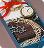 A jewelry box full of jewelry.