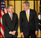 President George W. Bush stands with Colombian President Alvaro Uribe Tuesday, Jan. 13, 2009, during ceremonies honoring the 2009 Presidential Medal of Freedom Recipients in the East Room of the White House. White House photo by Chris Greenberg