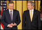 President George W. Bush stands with former Prime Minister Tony Blair of the United Kingdom as they listen to a citation honoring Mr. Blair as recipient of the 2009 Presidential Medal of Freedom. The presentation, held Tuesday, Jan. 13, 2009, in the East Room of the White House, will be the last such presentation by President Bush during his administration. White House photo by Chris Greenberg
