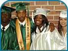 Four Students in Graduation Cap and Gown