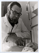 [C. Everett Koop examining an infant]. [ca. 1974].