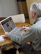 A man online learning about CAM.