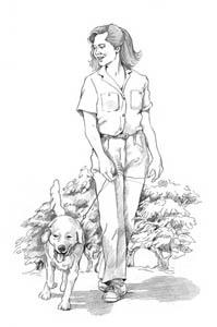 A lady walking a dog.