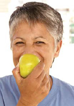Photo of a woman eating an apple