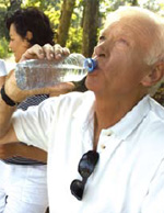 Photo of a man drinking water