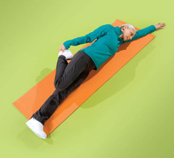 Photo of a woman doing thigh floor exercises