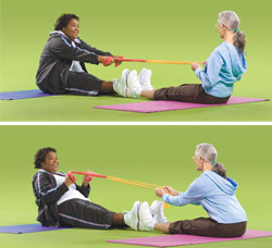 Photo of two women doing buddy stretch exercises