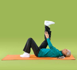 Photo of a woman doing back of leg floor exercises