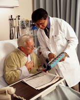Doctor and patient look at medical papers