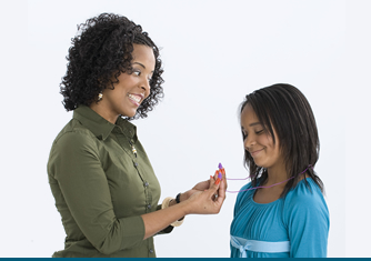 Parent educating child on hearing protectors