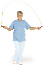 Photo of a woman exercising with a jump rope