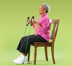 Photo of woman doing arm curl with resistance band exercise