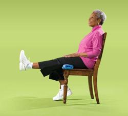 Photo of woman doing leg straightening exercise