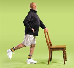 Photo of man doing back leg raise exercise