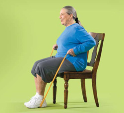 Photo of woman doing seated row with resistance band exercise