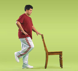 Photo of man doing stand on one foot exercise