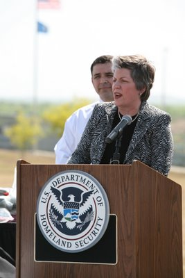 Secretary Napolitano, flanked by Congressman Henry Cuellar, discusses southwest border security efforts