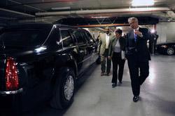 U.S. Secret Service Director Mark Sullivan and Special Agent Gregory Tate brief Secretary Napolitano on the presidential limousine, nicknamed