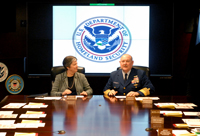 Secretary Napolitano and Coast Guard Commandant Adm. Allen listen to a briefing on global Coast Guard operations. (U.S. Coast Guard Photo/Bender)