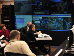 Thomas Muir briefs Secretary Napolitano about the flooding in North Dakota and Minnesota at the National Operations Center.