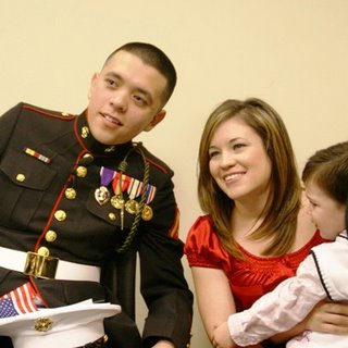 Marine Lance Corporal Jose Gasca, his wife Angelina and son.