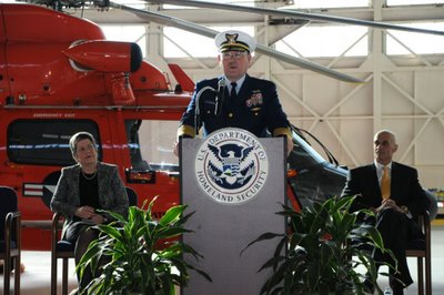 Commandant of the Coast Guard Admiral Thad Allen speaks at the Coast Guard Service Secretary Transfer of Authority in Washington, D.C., March 23, 2009, flanked by Secretary Napolitano and former Secretary Chertoff