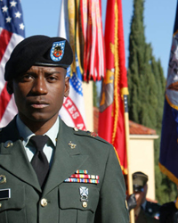 image of military man in front of flags