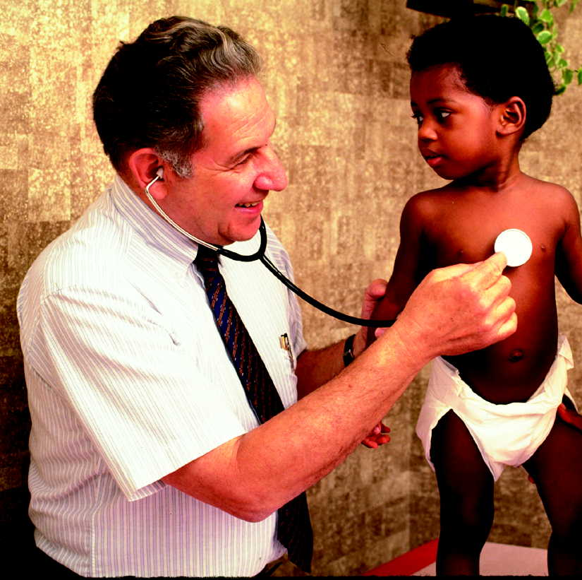Young child being examined by a doctor.