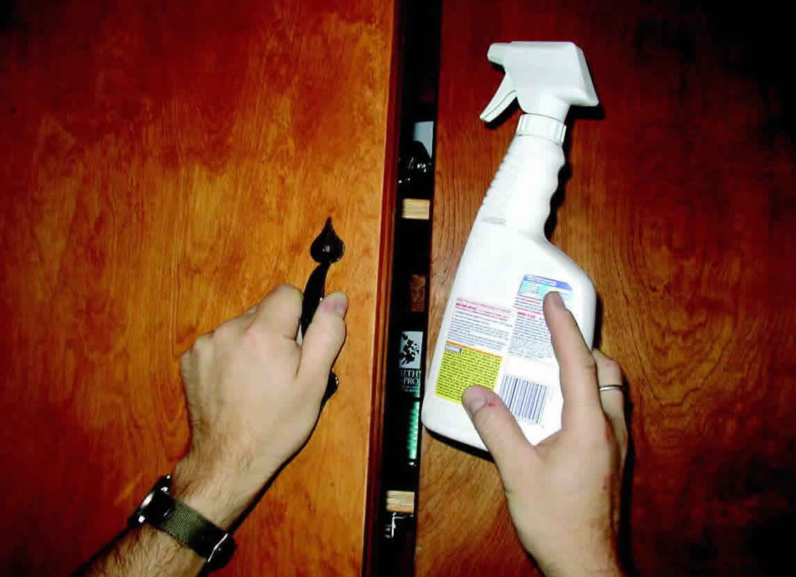 Storing a household cleaning product in an upper cabinet away from the reach of children.