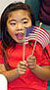 Young girl with American flag.