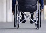 photo of a wheelchair in an airport terminal