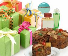 image of christmas gifts, perfume, and fruit cake