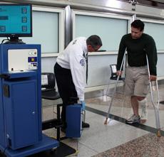 Photo of TSO screening a passenger using a CastScope